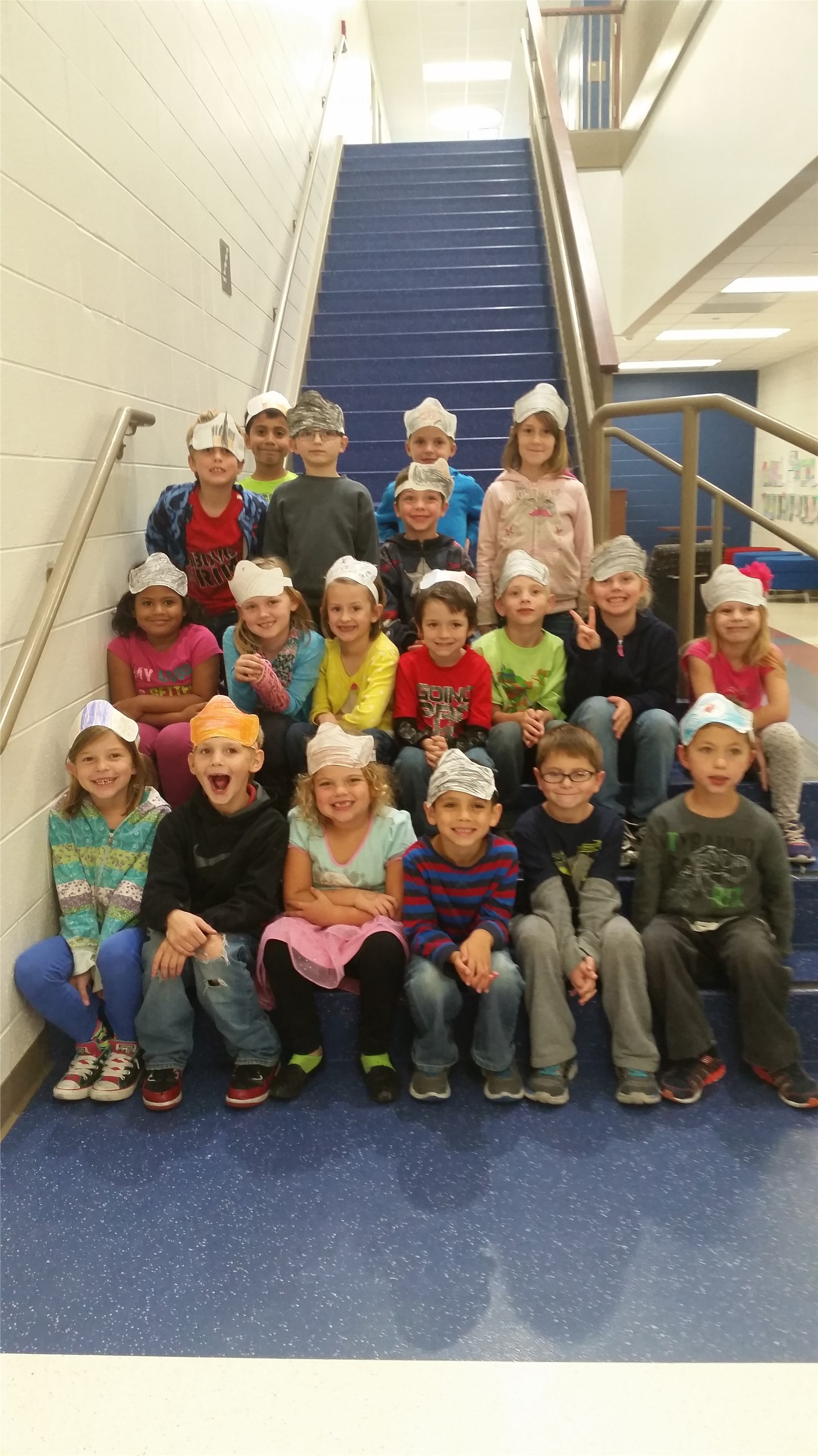 Students wearing crowns