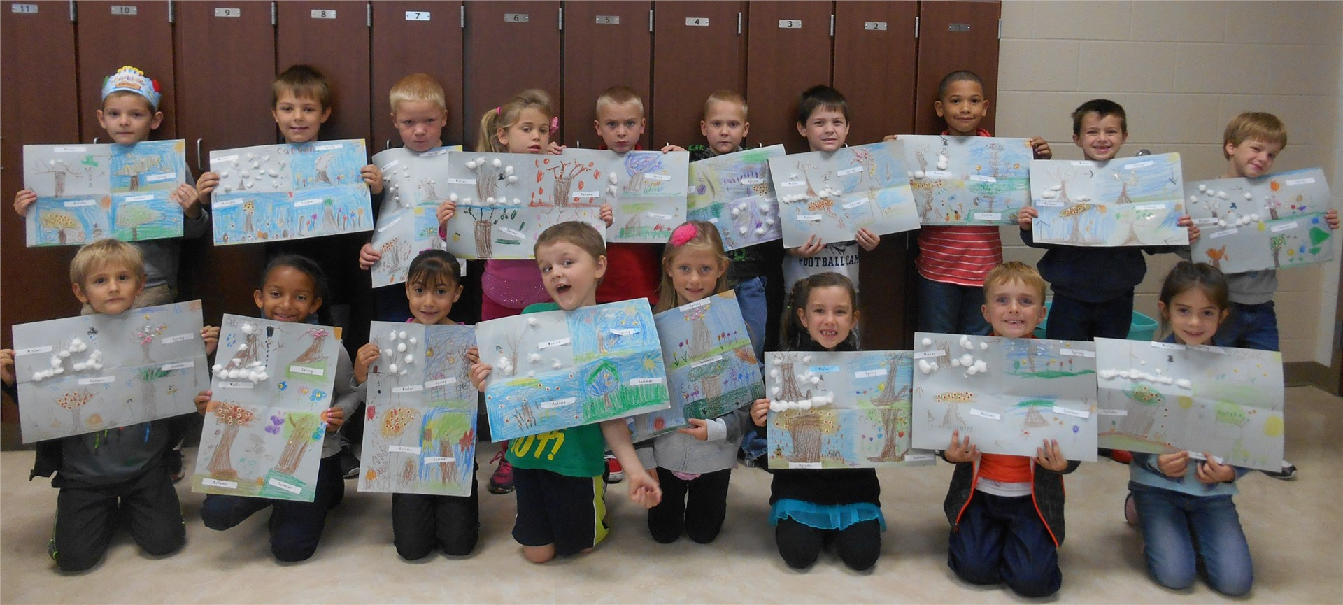 Students displaying artwork