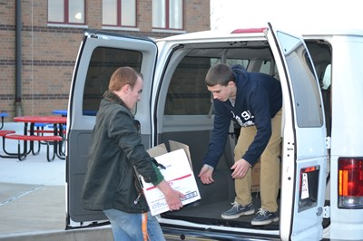 Students loading supplies