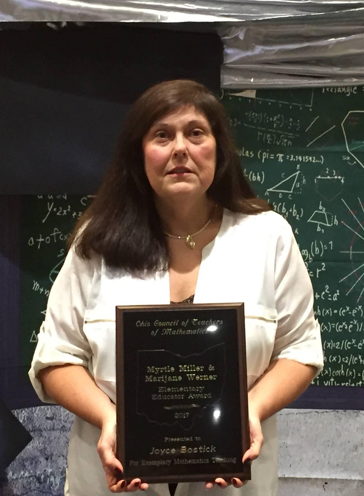 Mrs. Bostick receiving the OCTM Myrtle Miller/Marijane Werner Award