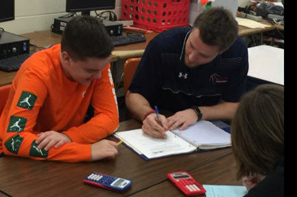 Mr. Grieshop working with a student in the Algebra Block
