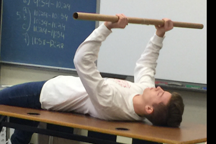 Student in Mrs. Ahrens class doing a demonstration speech on the bench press