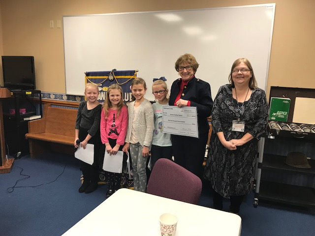 K-Kids present check to librarians
