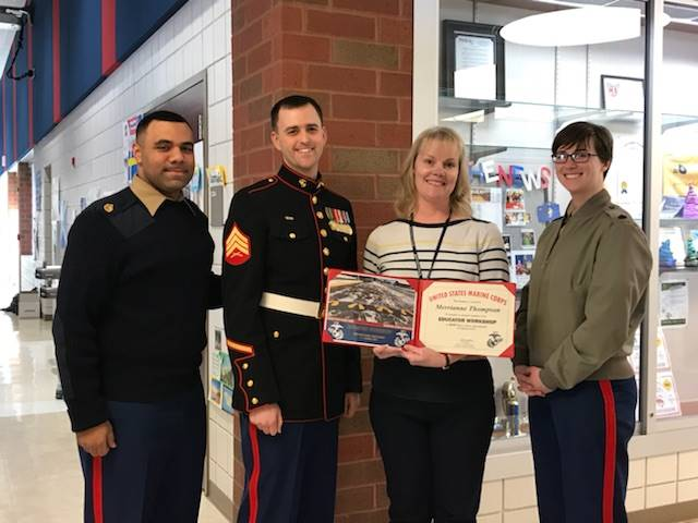 Mrs. Thompson receiving certificate for Marine Corp Educator Training