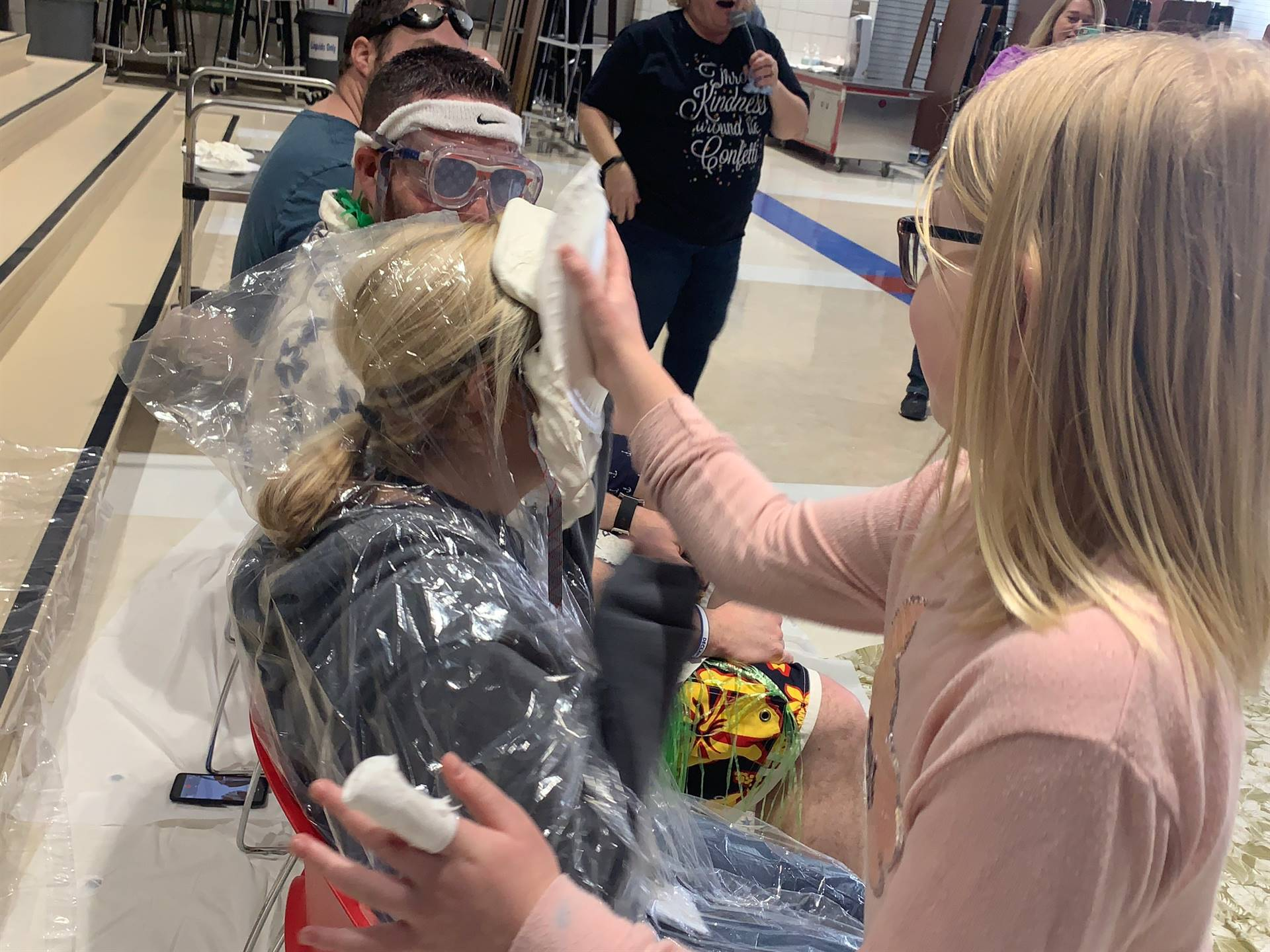 Mrs. Langston gets a pie in the face during the Pennies for Patients fundraiser