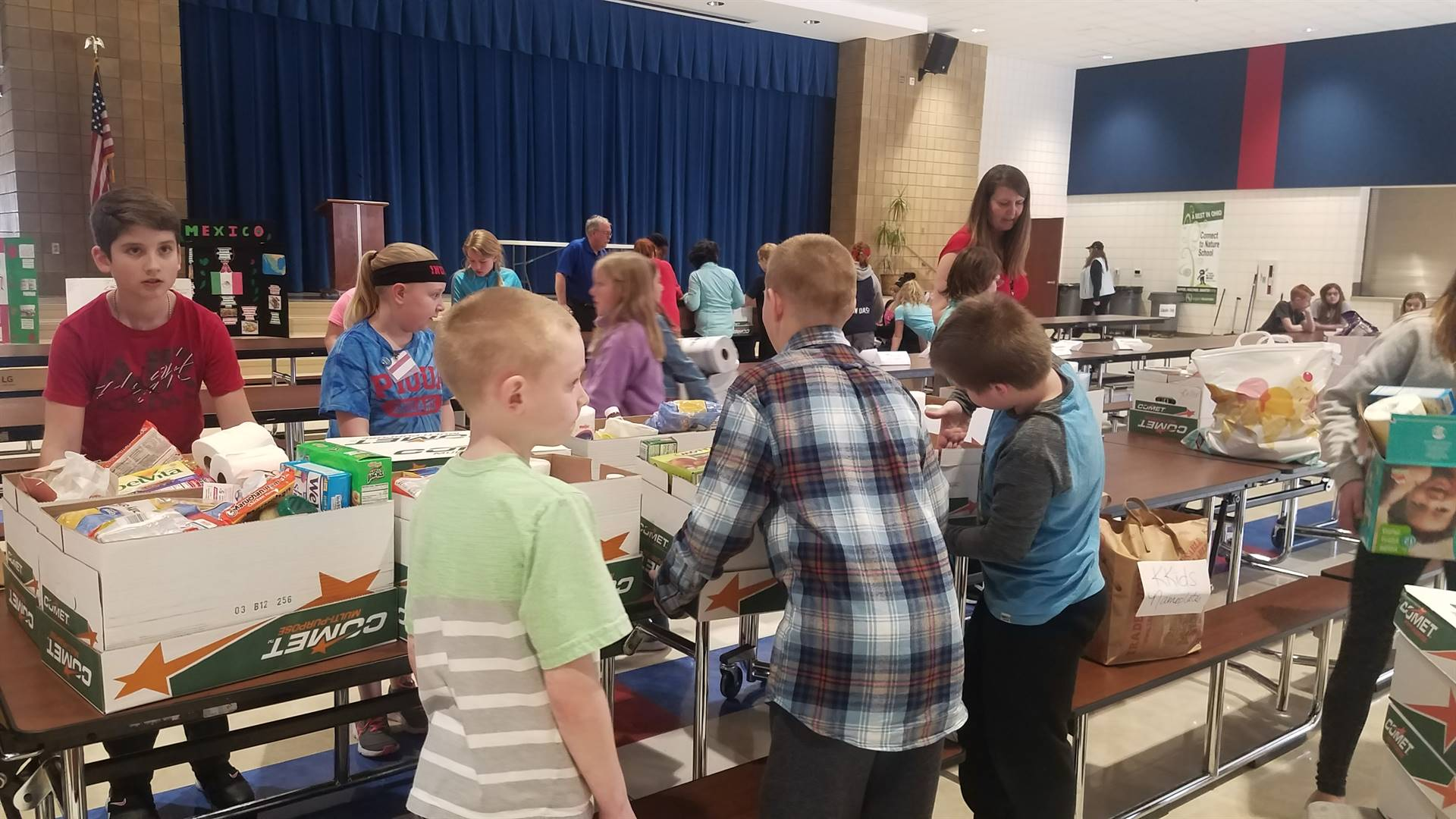 KKids sorting canned foods for donations