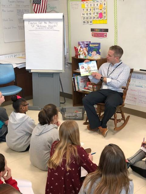 Mr. Butler reading to students